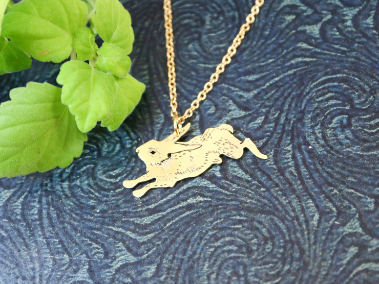 The rushing rabbit hand sawed & engraved brass necklace