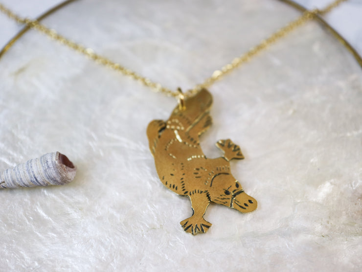 Platypus hand sawed & engraved brass necklace