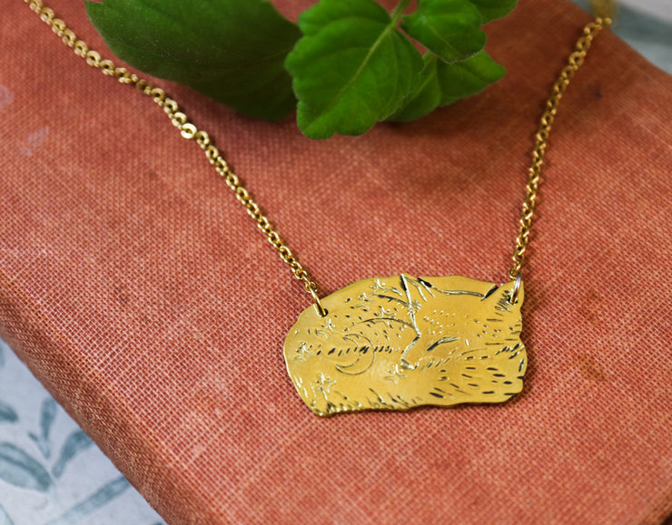 Curled up snoozing fox hand sawed & engraved brass necklace