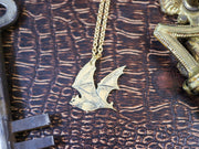 Flying bat hand sawed & engraved brass necklace
