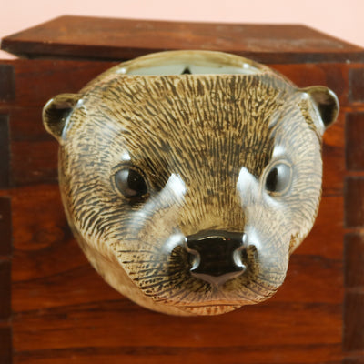 Small otter wallvase