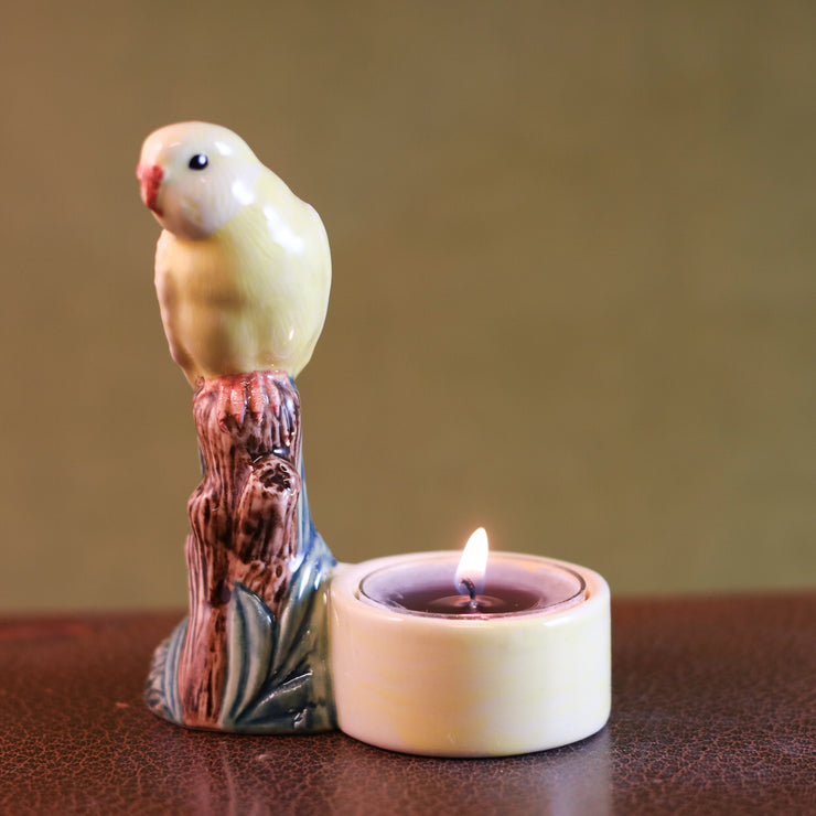 Yellow budgerigar tea light holder