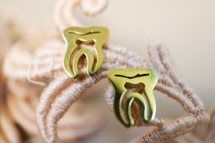 Golden tooth stainless stud earrings