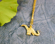 Golden brachiosaurus necklace