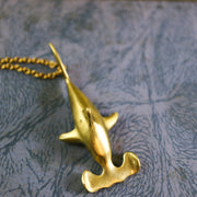 Golden hammerhead shark necklace