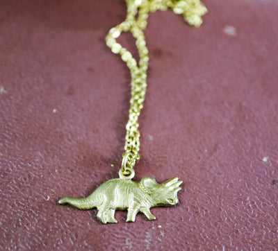 Golden triceratops necklace