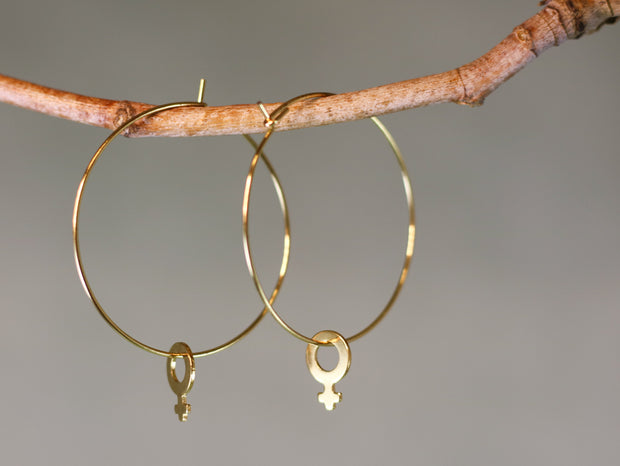 Big golden venus hoop earrings