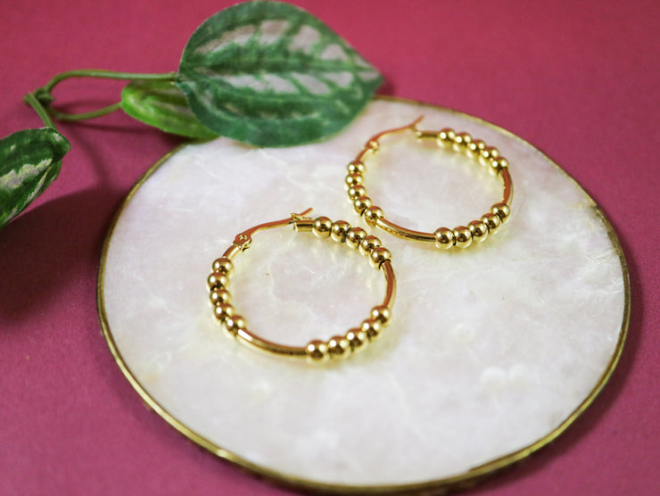 Medium dotty creole hoop earrings