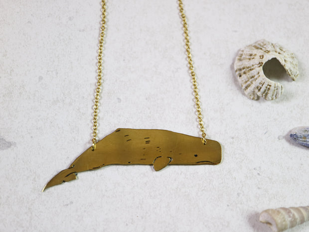 Big sperm whale hand sawed & engraved brass necklace