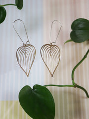 Long silver sweetheart philodendron earrings