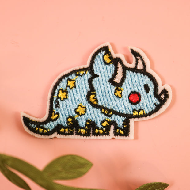 Tiny triceratops iron on patch
