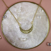 Small golden moon phase cresent necklace