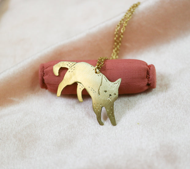 Jumping cat sawed & engraved brass necklace