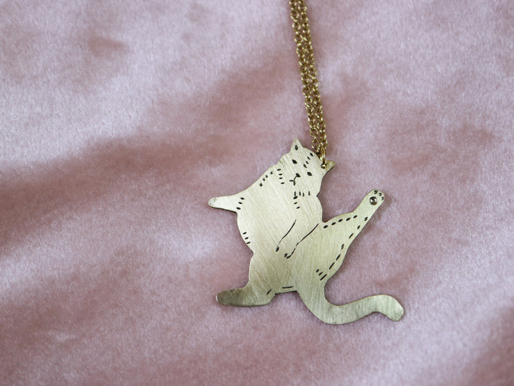 Judgemental cat facing right hand sawed & engraved brass necklace