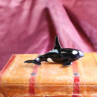Miniature killer whale figurine