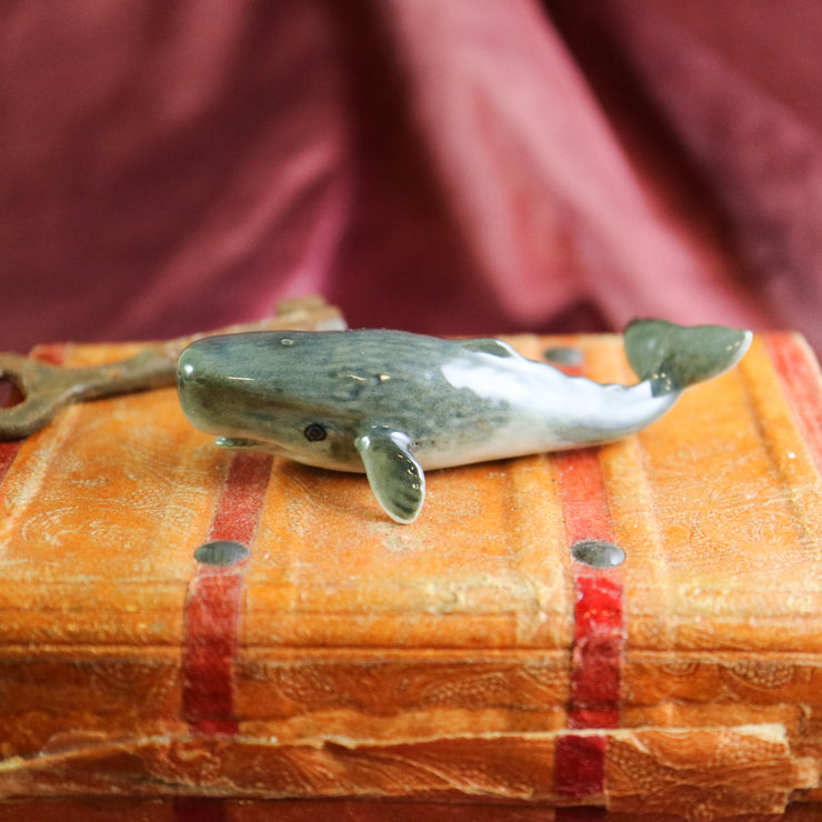 Miniature sperm whale figurine