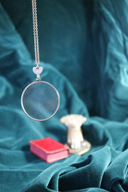 Antique golden opticians test lens necklace