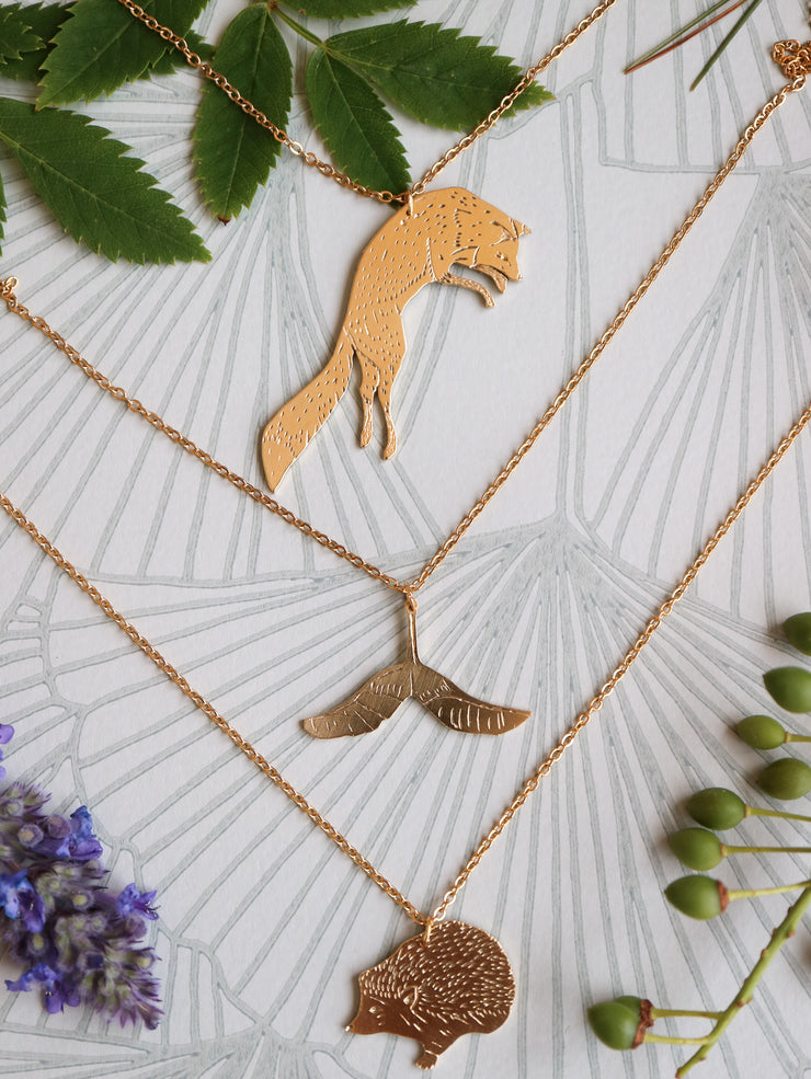 Jumping fox hand sawed & engraved brass necklace