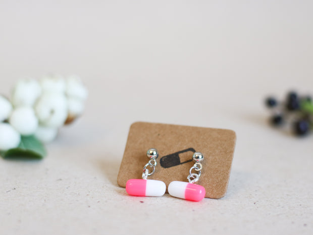 Silver pill dangle stud earrings