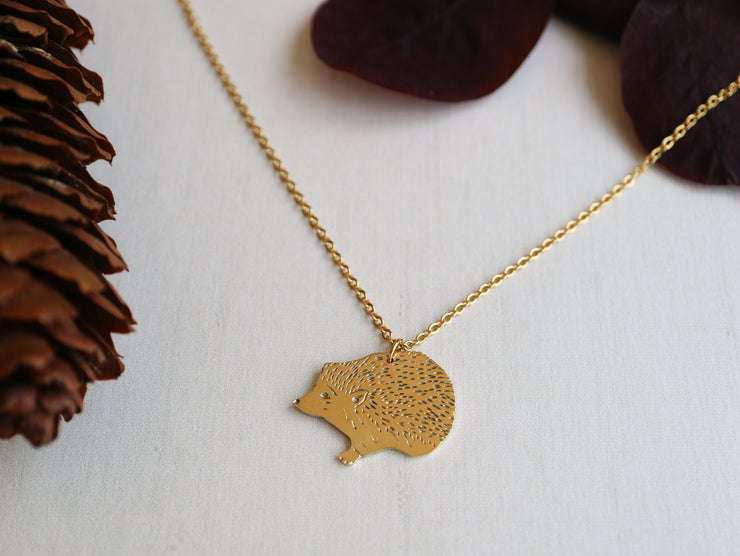 Curious hedgehog hand sawed & engraved brass necklace