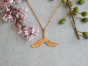 Maple seed hand sawed & engraved brass necklace
