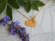Happy snail hand sawed & engraved brass necklace