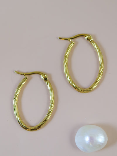 Twisted oval creole hoop earrings