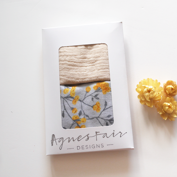 Ivory and yellow floral on grey twin pack muslin washcloths packaged