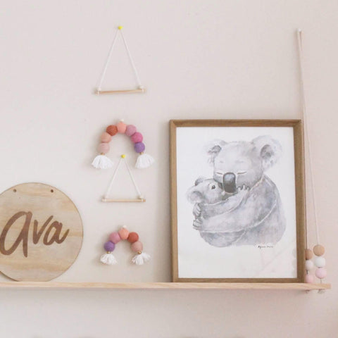 Mummy Koala hugging baby koala print styled on a hanging shelf