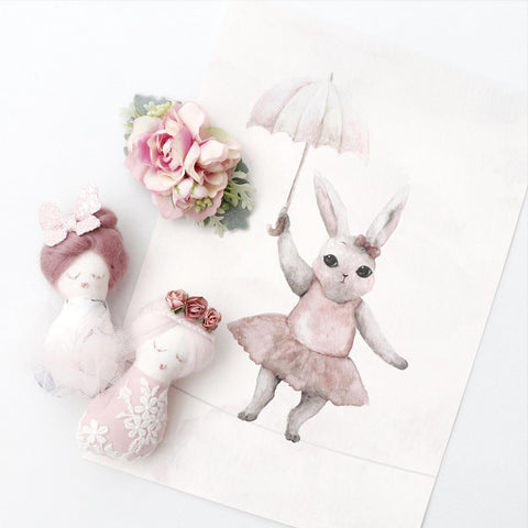 Bunny wearing tutu holding an umbrella print styled