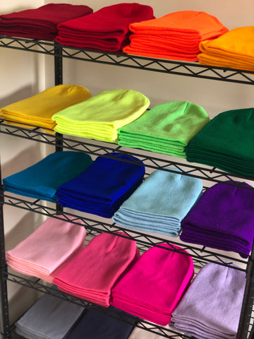 A rack with colorful beanies - Lift Down