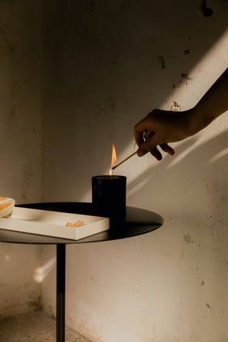 Lighting a candle for meditation.
