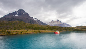Red boat in glacial water in Patagonia