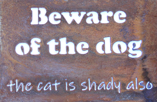 Beware of the dog the cat is shady also