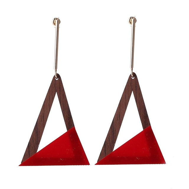 Step up you look with these stylish resin triangle long drop earrings. They are style statement in itself. Beautiful color contrast and wood feel gives them super trendy touch. Perfect for party , birthday , dinner.