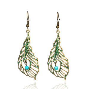 Boho leaf and feather style drop earrings are 2019 ethnic trend in jewellery. Add the punk and style in your looks with these pair of earrings. Perfect for everyday use. Best for party , picnic , birthday and lunch dates.