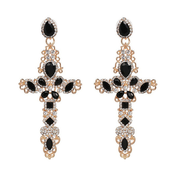 Cross earrings with diamonties. These earrings are large trendy with shine and style. The large drop earrings with a cross statement is a 2019 trend. Perfect for party , birthday , dinner and date.