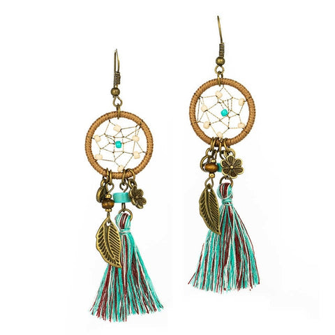 These boho style drop earrings have all the latest trends in one style. They got the celestial design , the charms , tassels and round hoop. The classic ferozi and brown color combo gives it attractive look. Perfect for lunch date , semi formal wear , picnic and gifts.