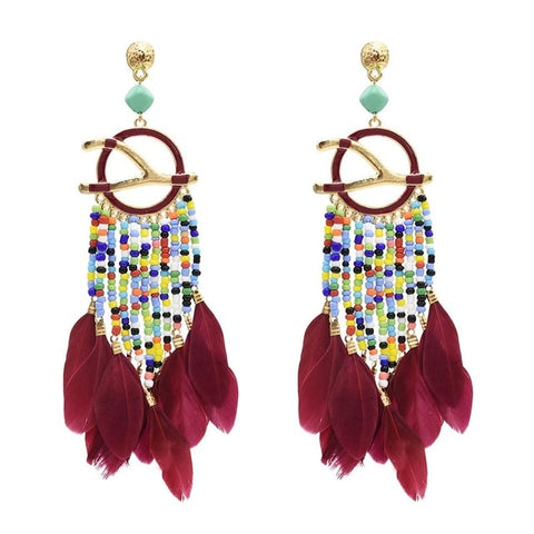 Boho feather, resin beads , geometric loops . bling and large statement earrings are 2019 trend. This style is a ethnic tribal signature to your look. Its exumberant and colorful with the feel of ethnicity and bohemian soul. Add the punk and vogue in your looks with these pair of earrings. Perfect for  Best for party , picnic , birthday, christmas,costue party , dinner , wedding , engagement and lunch dates.