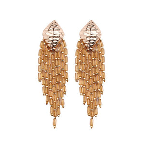 These Boho Style Ethnic Beaded Tassel earrings are hot in 2019 fsahion trends. The tassel beads are new addition in tassel drop earrings. They are funky , colorful , ethnic and trendy drop earrings with shine of beads and little bling of metal.Perfect for party , birthday, picnic or girls night out.