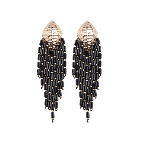 These Boho Style Ethnic Beaded Tassel earrings are hot in 2019 fsahion trends. The tassel beads are new addition in tassel drop earrings. They are funky , colorful , ethnic and trendy drop earrings with shine of beads and little bling of metal.Perfect for party , picnic, birthday or girls night out.