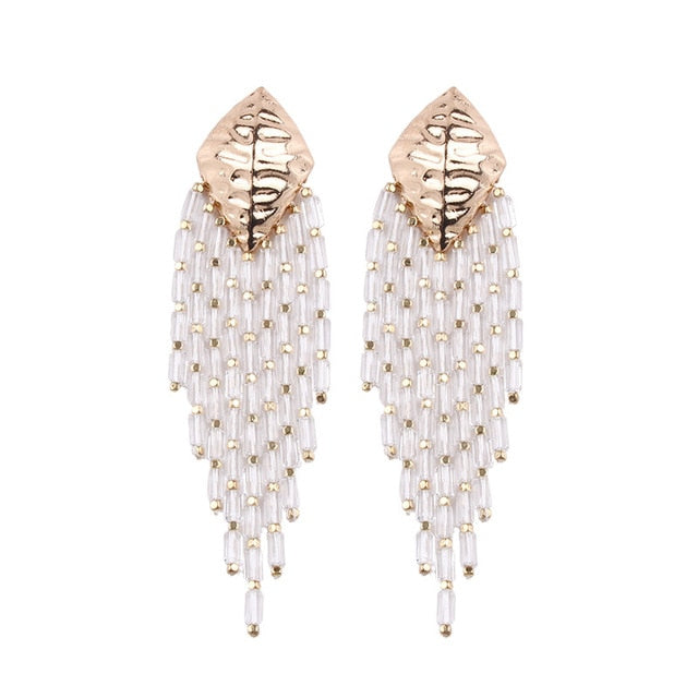 These Boho Style Ethnic Beaded Tassel earrings are hot in 2019 fsahion trends. The tassel beads are new addition in tassel drop earrings. They are funky , colorful , ethnic and trendy drop earrings with shine of beads and little bling of metal.Perfect for party , birthday , picnic or girls night out.