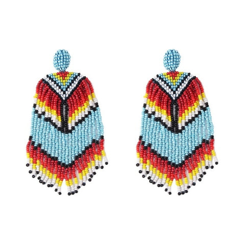 These Boho Style Ethnic Beaded Tassel earrings are hot in 2019 fsahion trends. The tassel beads are new addition in tassel drop earrings. They are funky , colorful , ethnic and trendy drop earrings with shine of beads and little bling of metal.Perfect for party , dinner , engagement , birthday, picnic or girls night out.