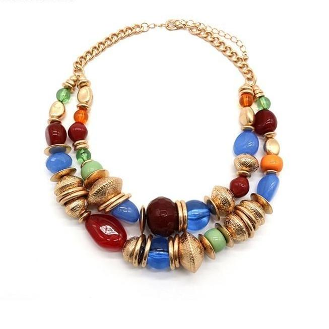 This resin and gold metal beads boho style necklace is extravaganza. It is extremely contemporary and trendy with a classic golden beads and vibrant colorful resin beads. It will give you a unique bohemian vogue statment and would turn the heads to you. Perfect for party , dinner , date , engagement , wedding , birthday , prom , christmas and lunch dates.