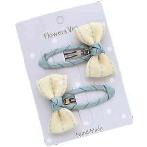 light yellow bow hair clips