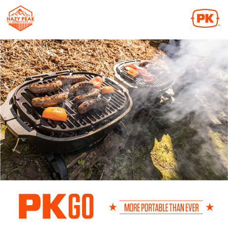 Image of PKGO Portable Grill and Smoker, open with food cooking on both halves.