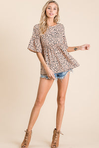 A short sleeve leopard woven top featuring ruffle with frill details
