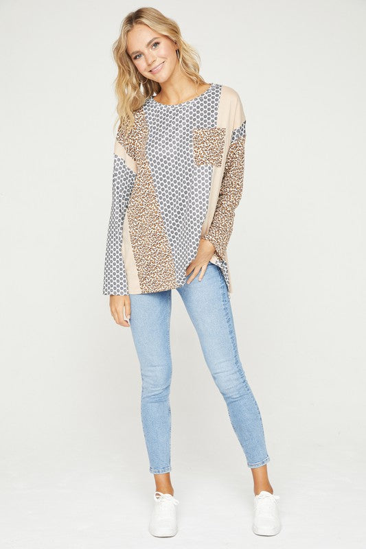 Print and solid color blocked knit top with pocket and high low hem details
