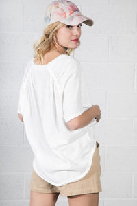 RELAXED BASIC SHIRT FEATURING A V-NECK