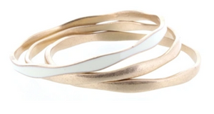 3 GOLD WAVY BANGLES WITH ONE IVORY EPOXY ACCENT